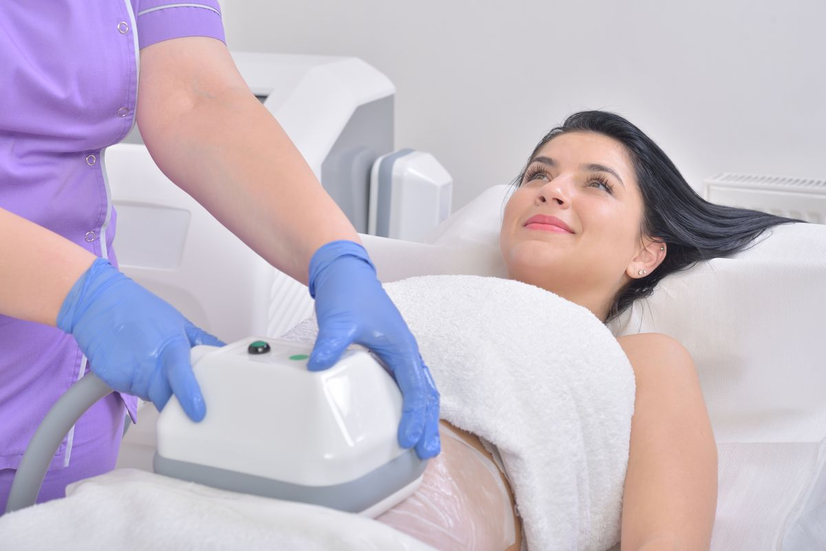 young and beautiful woman having a fat freezing procedure performed